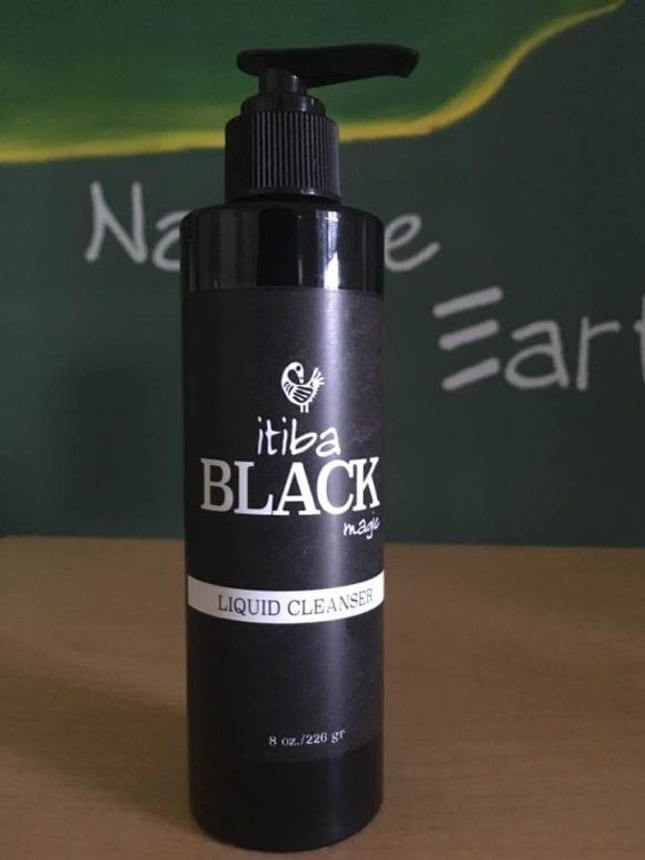 Bottle of itiba Black magic liquid cleanser for men's skincare